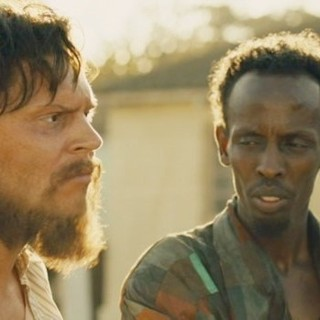 Evan Peters stars as Jay Bahadur and Barkhad Abdi stars as Abdi in Echo Bridge's The Pirates of Somalia (2017)