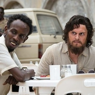 Barkhad Abdi stars as Abdi and Evan Peters stars as Jay Bahadur in Echo Bridge's The Pirates of Somalia (2017)