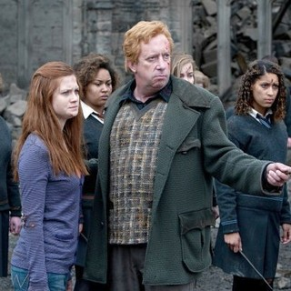 Harry Potter and the Deathly Hallows: Part II - Bonnie Wright stars as Ginny Weasley and Mark Williams stars as Arthur Weasley in Warner Bros. Pictures' Harry Potter and the Deathly Hallows: Part II (2011)