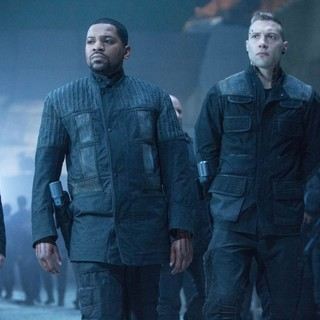 Mekhi Phifer stars as Max and Jai Courtney stars as Eric in Summit Entertainment's Divergent (2014)
