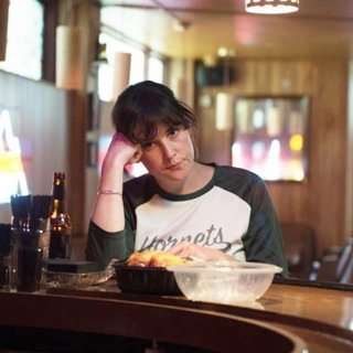 Melanie Lynskey stars as Ruth Kimke in Netflix's I Don't Feel at Home in This World Anymore (2017)