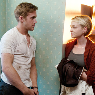 Ryan Gosling stars as Driver and Carey Mulligan stars as Irene in FilmDistrict's Drive (2011)