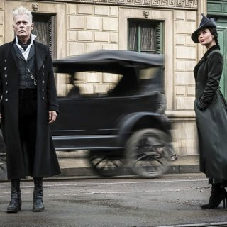 Johnny Depp stars as Gellert Grindelwald and Poppy Corby-Tuech stars as Rosier in Warner Bros. Pictures' Fantastic Beasts: The Crimes of Grindelwald (2018)