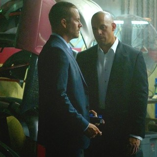Paul Walker stars as Brian O'Conner and Vin Diesel stars as Dominic Toretto in Universal Pictures' Furious 7 (2015) - fast-and-furious-7-02