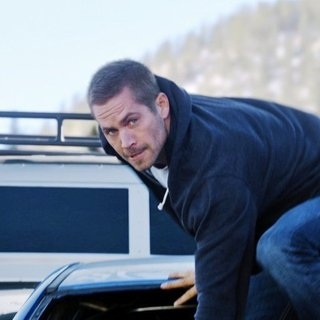 Paul Walker stars as Brian O'Conner in Universal Pictures' Furious 7 (2015) - fast-and-furious-7-10