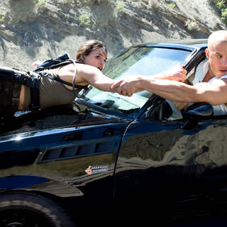 Michelle Rodriguez stars as Letty and Vin Diesel stars as Dominic Toretto in Universal Pictures' Fast and Furious (2009)