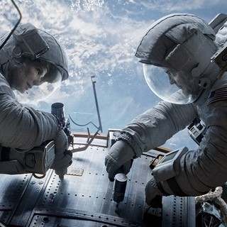 Sandra Bullock stars as Dr. Ryan Stone and George Clooney stars as Matt Kowalsky in Warner Bros. Pictures' Gravity (2013)