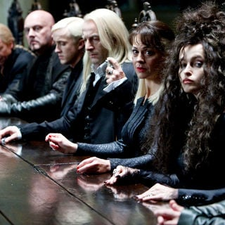 Tom Felton, Jason Isaacs, Helen McCrory and Helena Bonham Carter in Warner Bros. Pictures' Harry Potter and the Deathly Hallows: Part I (2010)