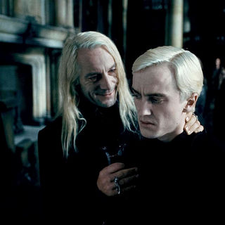 Tom Felton stars as Draco Malfoy and Jason Isaacs stars as Lucius Malfoy in Warner Bros. Pictures' Harry Potter and the Deathly Hallows: Part I (2010)