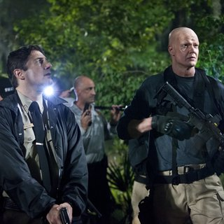 Zach Galligan stars as Sheriff Fowler and Derek Mears stars as Hawes in Dark Sky Films' Hatchet III (2013)