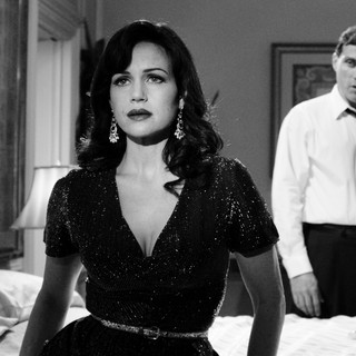 Carla Gugino stars as Hanna Click and Rufus Sewell stars as Felix in Gato Negro Films' Hotel Noir (2012)