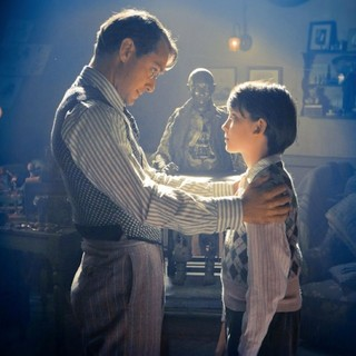 Jude Law stars as Hugo's Father and Asa Butterfield stars as Hugo Cabret in Paramount Pictures' Hugo (2011)
