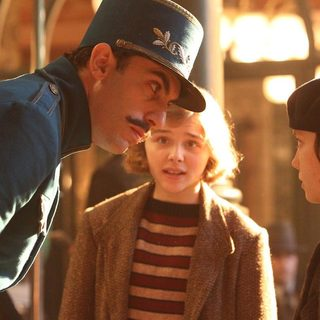 Sacha Baron Cohen, Chloe Moretz and Asa Butterfield in Paramount Pictures' Hugo (2011)