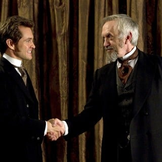Hugh Dancy stars as Mortimer Granville and Jonathan Pryce stars as Dr. Dalrymple in Sony Pictures Classics' Hysteria (2012). Photo credit by Ricardo Vaz Palma.