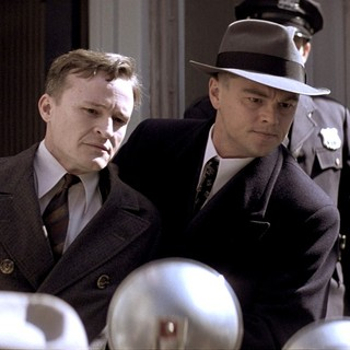 Damon Herriman stars as Bruno Hauptmann and Leonardo DiCaprio stars as J. Edgar Hoover in Warner Bros. Pictures' J. Edgar (2011)