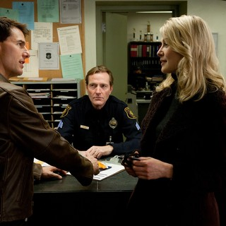 Tom Cruise stars as Jack Reacher and Rosamund Pike stars as Helen Rodin in Paramount Pictures' Jack Reacher (2012)