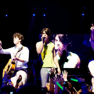Jonas Brothers: The 3D Concert Experience - Nick Jonas, Joe Jonas and Kevin Jonas in Walt Disney Pictures' Jonas Brothers: The 3D Concert Experience (2009). Photo credit by Frank Masi.