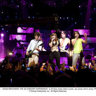 Jonas Brothers: The 3D Concert Experience - Nick Jonas, Demi Lovato, Joe Jonas and Kevin Jonas in Walt Disney Pictures' Jonas Brothers: The 3D Concert Experience (2009). Photo credit by Frank Masi.