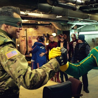 Jim Carrey stars as Colonel Stars and Stripes and Aaron Johnson stars as Dave Lizewski / Kick-Ass in Universal Pictures' Kick-Ass 2 (2013)
