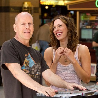 Bruce Willis stars as Dink Heimowitz and Rebecca Hall stars as Beth Raymer in Radius-TWC's Lay the Favorite (2012)