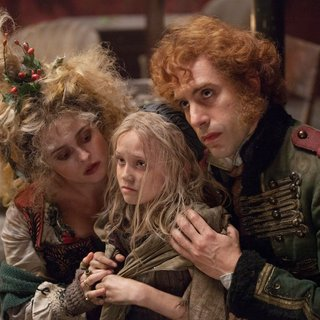 Sacha Baron Cohen, Isabelle Allen and Helena Bonham Carter in Universal Pictures' Les Miserables (2012)