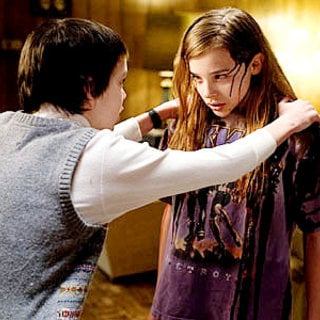Kodi Smit-McPhee stars as Owen and Chloe Moretz stars as Abby in Overture Films' Let Me In (2010)