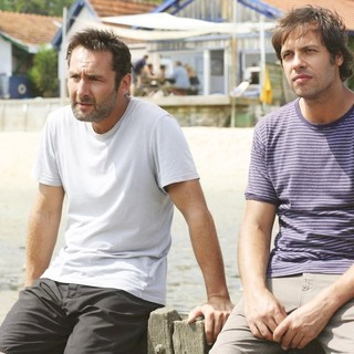 Gilles Lellouche stars as Eric and Laurent Lafitte stars as Antoine in MPI Media Group's Little White Lies (2012)