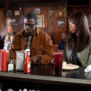 Lance Gross stars as Brice and Brandy stars as Melinda in Lionsgate Films' Tyler Perry's Temptation (2013)