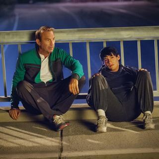 McFarland, USA - Kevin Costner stars as Jim White and Carlos Pratts stars as Thomas in Walt Disney Pictures' McFarland, USA (2015)