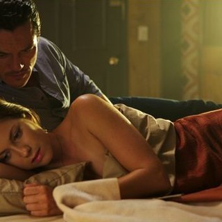 Luke Evans stars as Driver and Lindsey Shaw stars as Amber in Anchor Bay Films' No One Lives (2013)