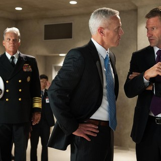 Phil Austin stars as Vice President Rodriguez and Aaron Eckhart stars as President Benjamin Asher in FilmDistrict's Olympus Has Fallen (2013)
