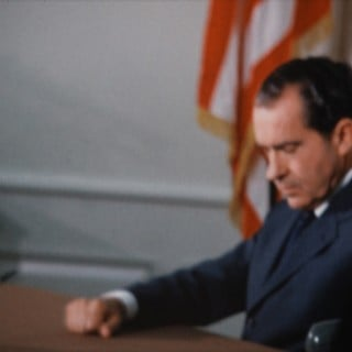 President Nixon in the Oval Office preparing for his historic phone call to Apollo 11 astronauts Neil Armstrong and Buzz Aldrin, who were at that very moment landing on the moon (July 20, 1969)