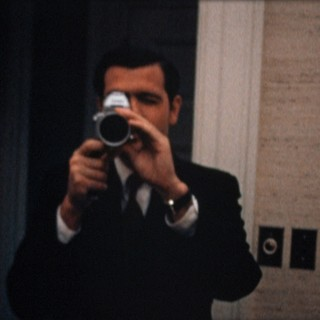 Special Assistant Dwight Chapin films Haldeman filming him at the White House on the night of the Apollo 11 moon landing (July 20, 1969)
