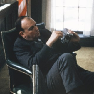 Chief Domestic Advisor John Ehrlichman fiddles with his Super 8 camera during a particularly boring staff meeting at the White House