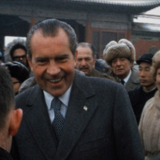 President and Mrs. Nixon mingle with the locals in China while the American press looks on (February 1972)