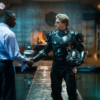 Idris Elba stars as Stacker Pentecost and Charlie Hunnam stars as Raleigh Antrobus in Warner Bros. Pictures' Pacific Rim (2013)