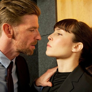 Paul Anderson and Noomi Rapace (Isabelle James) in Entertainment One's Passion (2013)