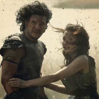 Kit Harington stars as Milo and Emily Browning stars as Cassia in TriStar Pictures' Pompeii (2014)