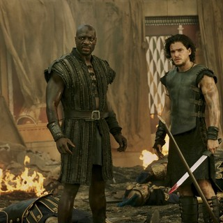 Adewale Akinnuoye-Agbaje stars as Atticus and Kit Harington stars as Milo in TriStar Pictures' Pompeii (2014)