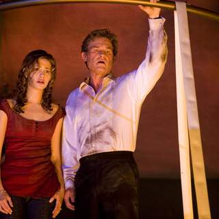 EMMY ROSSUM as Jennifer Ramsey and KURT RUSSELL as Robert Ramsey in Warner Bros Pictures' Poseidon (2006)
