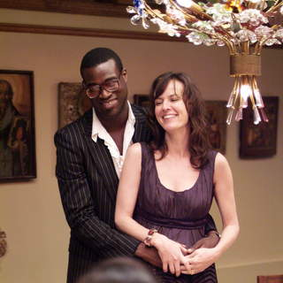 Tunde Adebimpe as Sidney and Rosemarie DeWitt as Rachel in Sony Pictures Classics' Rachel Getting Married (2008). Photo by Bob Vergara. - rachel_getting_married21