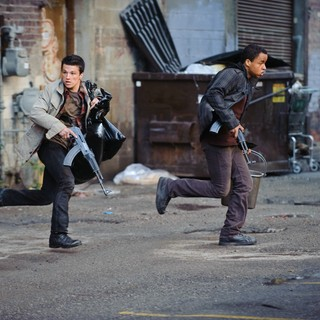 Josh Hutcherson stars as Robert and Connor Cruise stars as Daryl Jenkins in FilmDistrict's Red Dawn (2012)