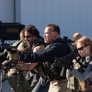 Joe Manganiello, Arnold Schwarzenegger and Mireille Enos in Open Road Films' Sabotage (2014). Photo credit by Blake Tyers. - sabotage02