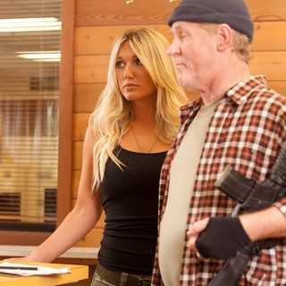 Brooke Hogan stars as Sandy Powers and Robert Pike Daniel stars as Angus in Little Dragon Productions' Sand Sharks (2012)