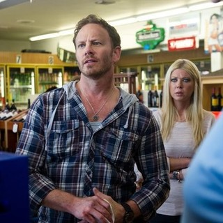 Ian Ziering stars as Fin Shepard and Tara Reid stars as April Wexler in Regal Entertainment Group's Sharknado (2013)