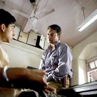 Dev Patel stars as Jamal Malik and Irfan Khan stars as Police Inspector in Fox Searchlight Pictures' Slumdog Millionaire (2008). Photo credit by Ishika Mohan.