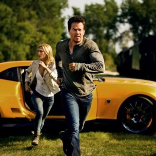 Transformers: Age of Extinction - Nicola Peltz stars as Tessa Yeager and Mark Wahlberg stars as Cade Yeager in Paramount Pictures' Transformers: Age of Extinction (2014). Photo credit by Andrew Cooper.