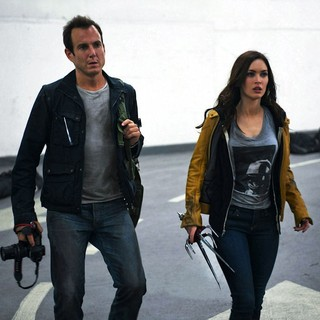 Teenage Mutant Ninja Turtles - Will Arnett stars as Vernon Fenwick and Megan Fox stars as April O'Neil in Paramount Pictures' Teenage Mutant Ninja Turtles (2014)