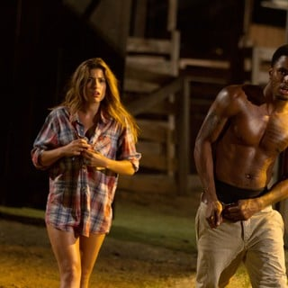 Tania Raymonde stars as Nikki and Trey Songz stars as Ryan in Lionsgate Films' Texas Chainsaw 3D (2013) - texas-chainsaw-3d-still09