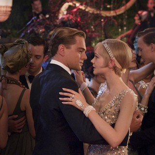 Leonardo DiCaprio stars as Jay Gatsby and Carey Mulligan stars as Daisy Buchanan in Warner Bros. Pictures' The Great Gatsby (2013)